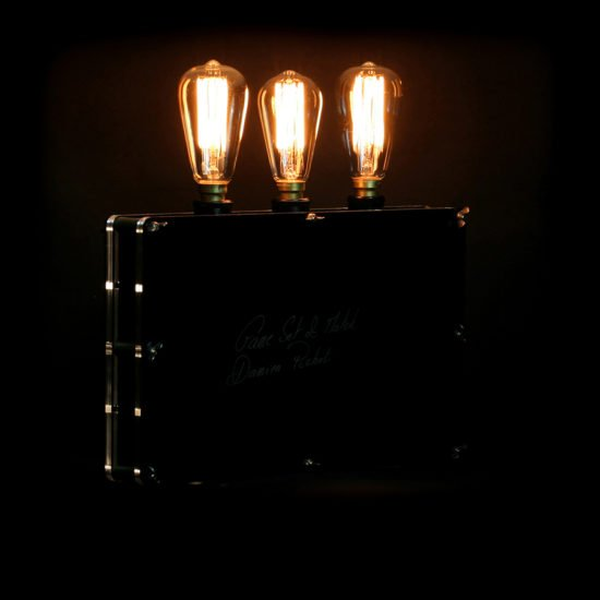 The original handcrafted lighting game set and match offered for sale by Light My Vintage with its sober lines and impeccable finish