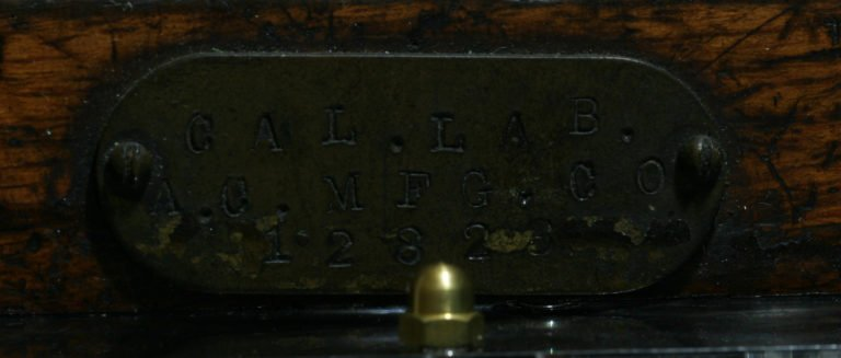 Brass label indicating its follow-up in the laboratory